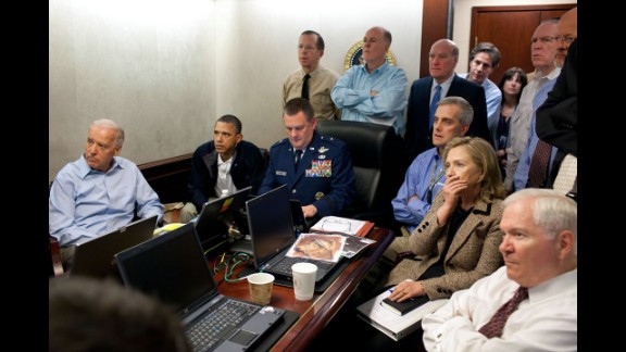 """President Barack Obama and members of his national security team monitor the Navy SEALs raid that killed Osama bin Laden in 2011. It was a crucial moment in American history, and White House photographer Pete Souza captured the tension in the room. """"It was probably one of the most anxiety-filled periods of time, I think, in the lives of the people who were assembled,"""" counterterrorism adviser John Brennan later told reporters. A classified document on the table was obscured by the White House."""
