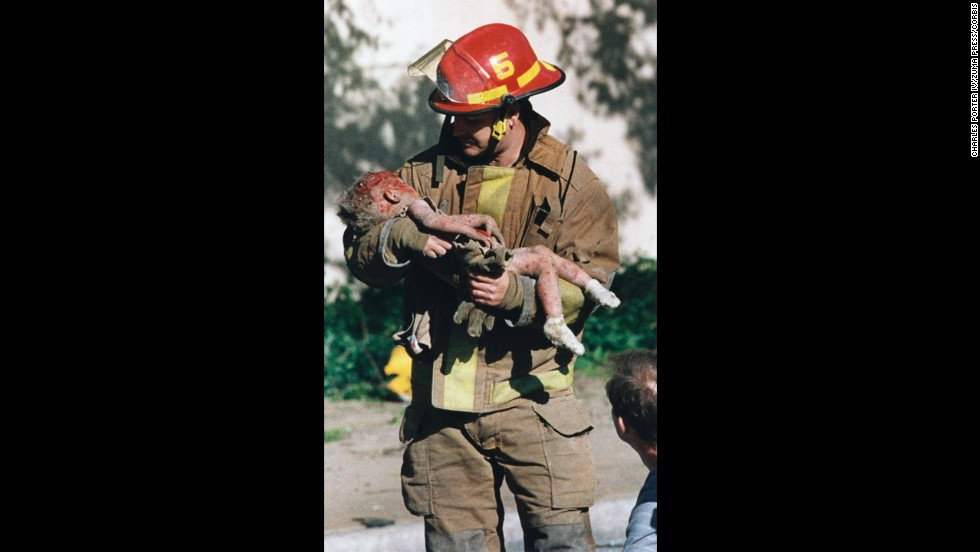 "Aspiring photojournalist Charles Porter was working near the Alfred P. Murrah Federal Building in Oklahoma City in 1995 when ""there was just a huge, huge explosion."" He rushed to the scene and saw firefighter Chris Fields emerge from the rubble holding a dying infant, 1-year-old Baylee Almon. Porter's Pulitzer Prize-winning photograph of the moment became a symbol of the Oklahoma City bombing, which claimed 168 lives."