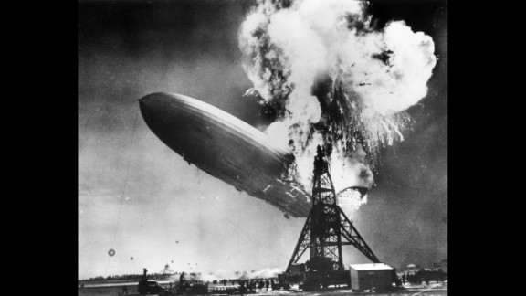 """In 1937, Sam Shere photographed the Hindenburg disaster while on assignment in New Jersey. The crash killed 36 people and ended the era of passenger-carrying airships, which were once hailed as the future of flight. """"I had two shots in my (camera) but I didn't even have time to get it up to my eye,"""" Shere later said. """"I literally shot from the hip -- it was over so fast there was nothing else to do."""""""
