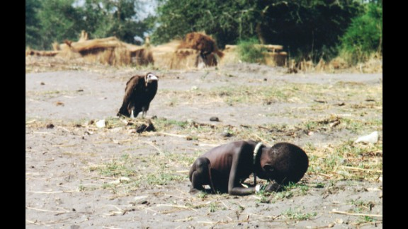 Kevin Carter's 1993 photograph of a starving child in southern Sudan brought him worldwide attention -- and criticism. Carter said the girl reached a nearby feeding center after he drove the vulture off, but questions persisted about why he didn't carry her there himself. Months after winning a Pulitzer Prize for the image, the South African photographer committed suicide. He was struggling with depression and coping with the recent death of his close friend and colleague Ken Oosterbroek.
