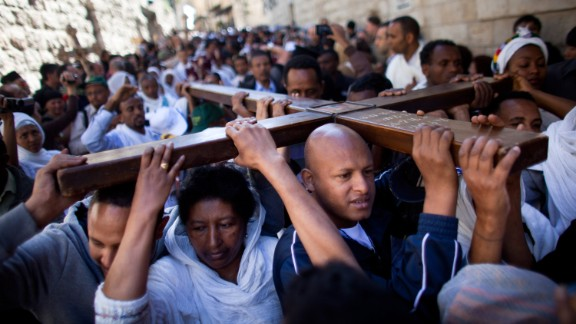 Christian pilgrims hold a wooden cross as they take part in the Good Friday procession along the Via Dolorosa. The Via Dolorosa leads to the Church of the Holy Sepulchre, where Christian tradition says Jesus was crucified and buried.