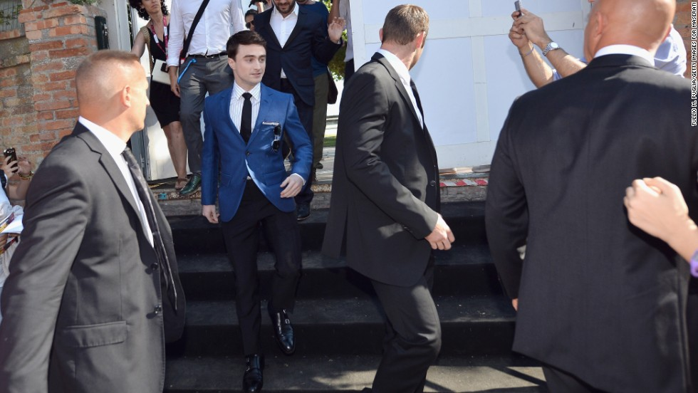 Daniel Radcliffe is escorted to the festival on September 1.