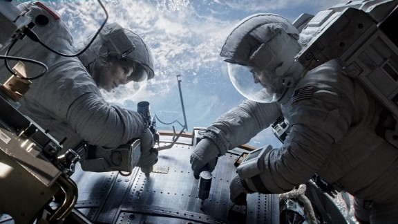 "Sandra Bullock as Dr. Ryan Stone and George Clooney as Matt Kowalsky in ""Gravity."""