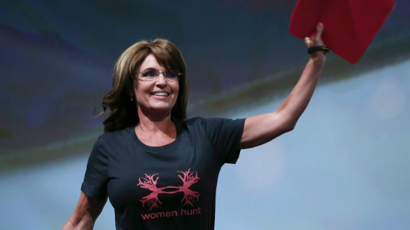 HOUSTON, TX - MAY 03: Former Alaska Gov. Sarah Palin waves before speaking during the 2013 NRA Annual Meeting and Exhibits at the George R. Brown Convention Center on May 3, 2013 in Houston, Texas. More than 70,000 peope are expected to attend the NRA's 3-day annual meeting that features nearly 550 exhibitors, gun trade show and a political rally. The Show runs from May 3-5. (Photo by Justin Sullivan/Getty Images)
