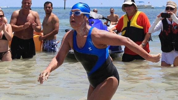 Image #: 24144968    U.S. long-distance swimmer Diana Nyad , 64, walks to dry sand, completing her swim from Cuba as she arrives in Key West, Florida, September 2, 2013. Nyad has become the first person to swim from Cuba without a shark cage. REUTERS/Andrew Innerarity  (UNITED STATES - Tags: SPORT SWIMMING TPX IMAGES OF THE DAY)       REUTERS /Andrew Innerarity /LANDOV