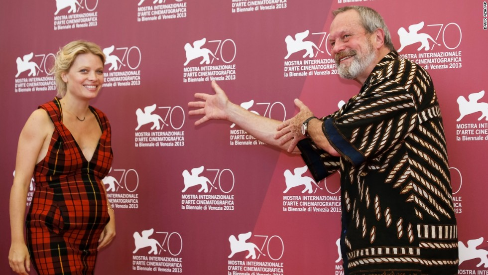 "Actress Melanie Thierry, left, and director Terry Gilliam pose during the photo call for the film ""The Zero Theorem"" on September 2."