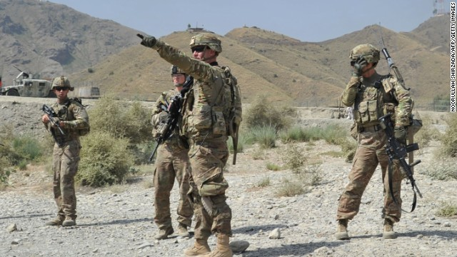 US soldiers gather after a clash between Taliban and Afghan security forces in Torkham on Monday.