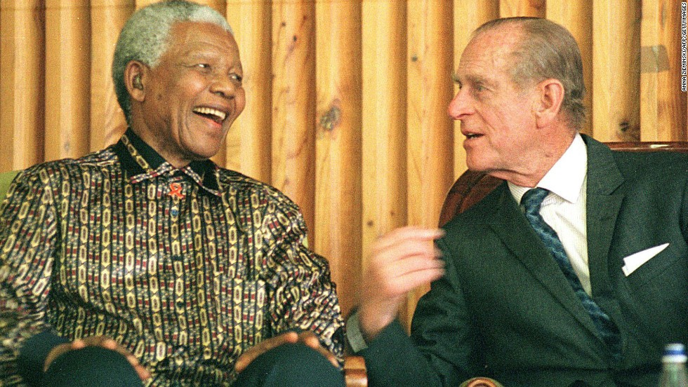 Former South African President Nelson Mandela chats with Prince Philip during an awards ceremony for juvenile prisoners at Drakenstein prison outside Cape Town, South Africa, on November 5, 2000.