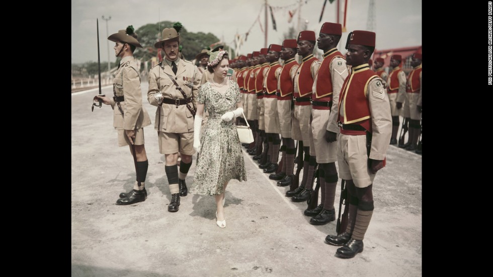 During her Commonwealth Tour, Queen Elizabeth II inspects men of the Queen's Own Nigeria Regiment, Royal West African Frontier Force at Kaduna Airport in Kaduna, Nigeria, on February 2, 1956.