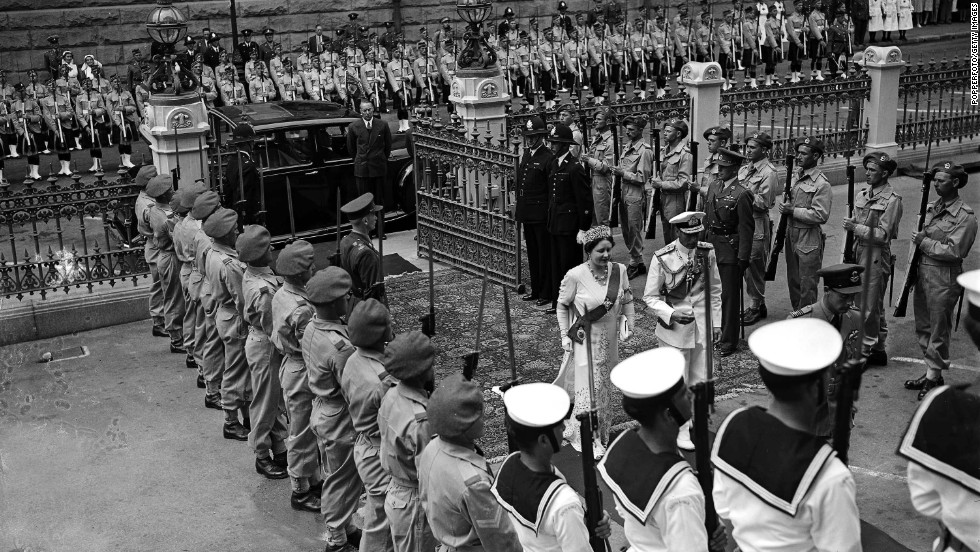 King George VI and Queen Elizabeth arrive at the Senate House in Cape Town, South Africa, where the king opened Parliament on February 26, 1947.