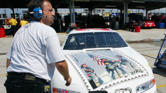 "NASCAR driver Jamie McMurray decorated the hood of his car with a replica of the ""Heroes of 2001"" stamp. A crew member helps ready the car at the Daytona International Speedway in 2002."