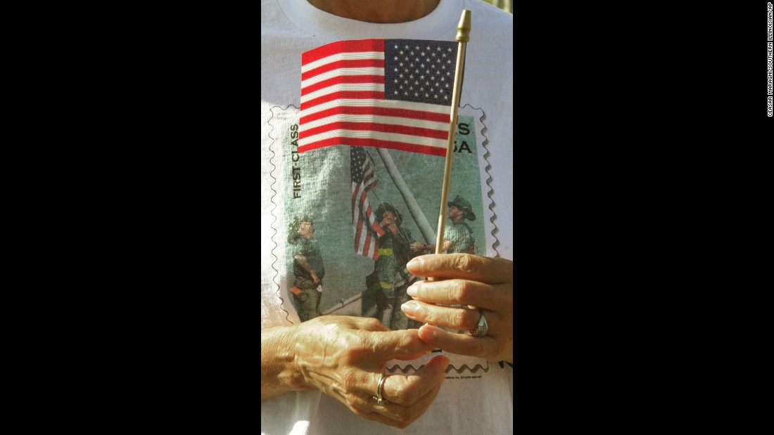 The image can also be found on T-shirts, like this one worn by Venita Bradford at a memorial service in Energy, Illinois, on September 11, 2002.