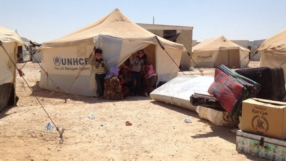 A family arrives at the Zaatari refugee camp in Jordan in August 2013.