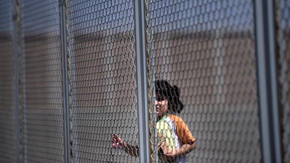 A Syrian girl stands behind a fence at Bulgaria's shelter near Lyubimets in August 2013.