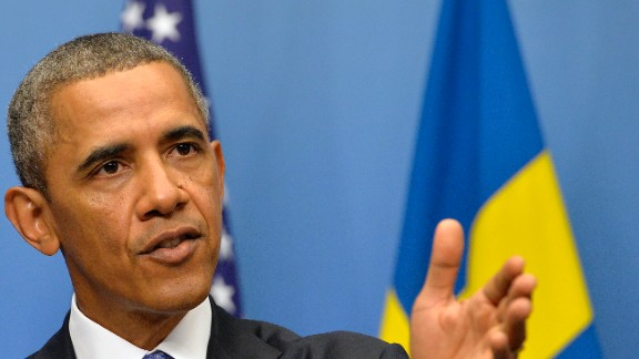 Caption: US President Barack Obama answers a question on Syria during a joing press conference with Swedish Prime Minister after their bilateral meeting at the Rosenbad Building in Stockholm on September 4, 2013. Obama met with Fredrik Reinfeldt upon arrival in Sweden on a two-day official trip before leaving for Russia, where he will attend G20 summit. Russia on Thursday hosts the G20 summit hoping to push forward an agenda to stimulate growth but with world leaders distracted by divisions on the prospect of US-led military action in Syria. AFP PHOTO / JEWEL SAMAD (Photo credit should read JEWEL SAMAD/AFP/Getty Images)