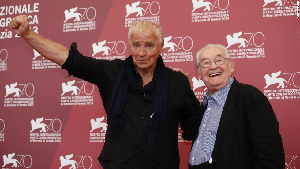 "Writer Janusz Glowacki, left, and director Andrzej Wajda pose for photographers during the photo call for the film ""Walesa"" at the 70th Venice Film Festival on Thursday, September 5. The festival is going on from August 28 through September 7 in Italy."