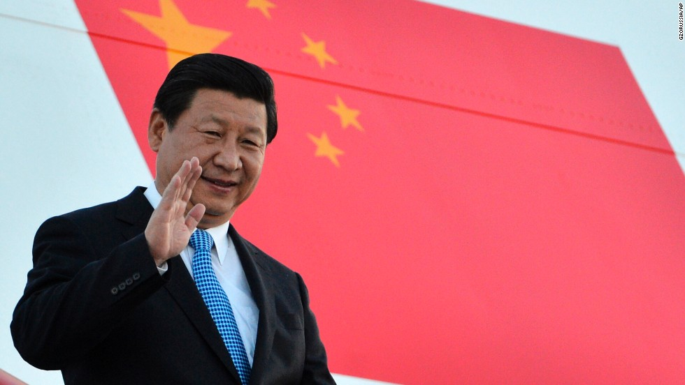 China's President Xi Jinping waves as he arrives in St. Petersburg on Wednesday, September 4.