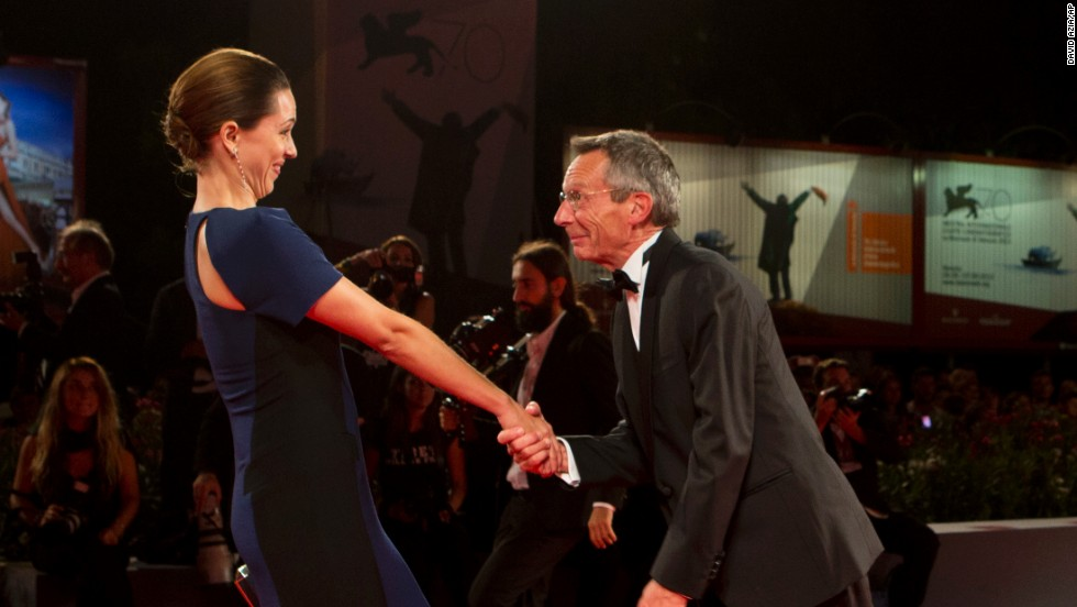 "Director Patrice Leconte and actress Rebecca Hall of the film ""A Promise"" have fun on the red carpet on September 4."