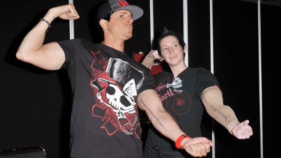 """Zak Bagans, host of Travel Channel's """"Ghost Adventures"""" laughs it up with a fan at a Comic-Con convention."""