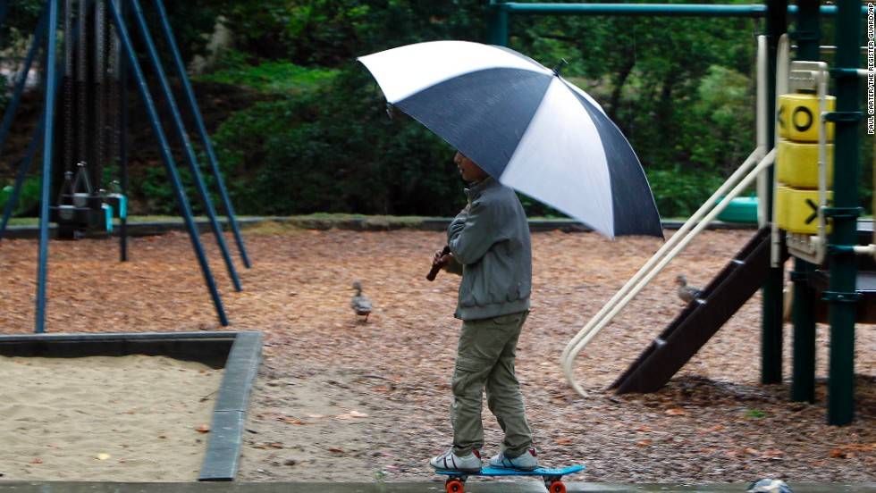 Suhayb Abdul Qader, 11, ignores the rain and plays in Island Park in Springfield, Oregon, on September 5.