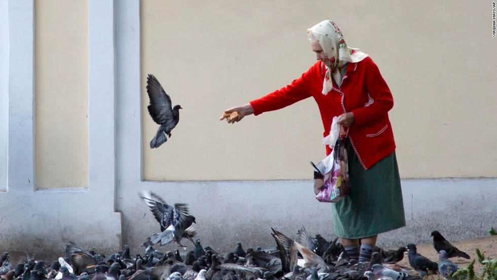 A woman feeds pigeons near the Alexander Nevsky Monastery in St. Petersburg, Russia, on September 3. The Alexander Nevsky Monastery complex, which is currently under renovation, is home to some of the oldest buildings in the city.
