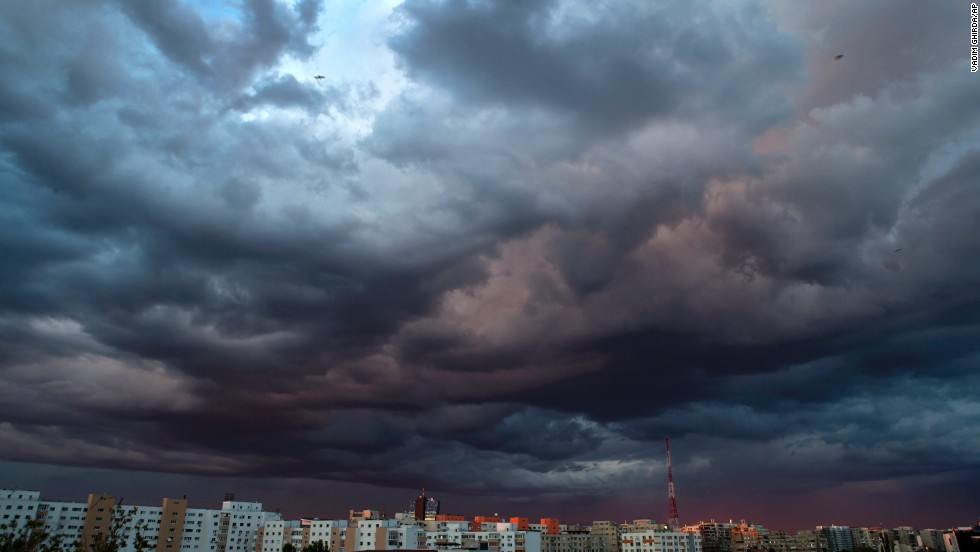 Clouds are illuminated by the setting sun in Bucharest, Romania, on September 3.