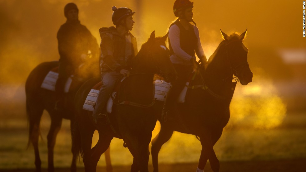 Track riders and their horses work out in cold and steamy conditions during a trackwork session at Flemington Racecourse in Melbourne, Australia, on September 3.