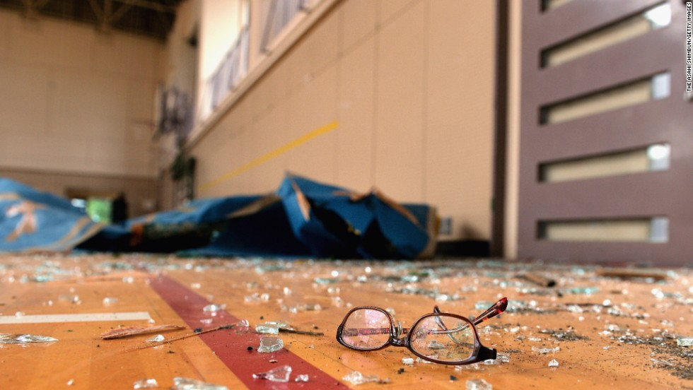 Shattered glass and a pair of spectacles lay in a gymnasium where one student was injured at Hokuyo Junior High School in Koshigaya, Japan, on Monday, September 2. Dozens of people were injured when very strong winds and an apparent tornado struck two cities near Tokyo.