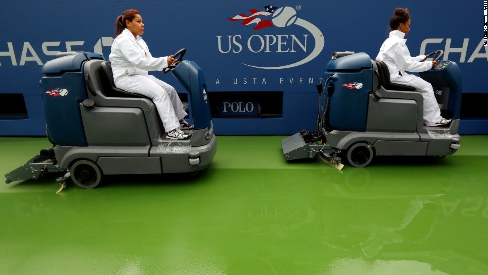 Court attendants dry a tennis court in Arthur Ashe Stadium following a rain delay on day eight of the 2013 U.S. Open at USTA Billie Jean King National Tennis Center in New York on September 2.