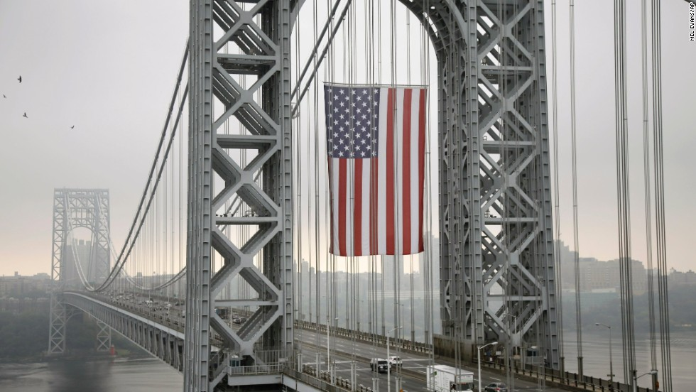 The largest free-flying American flag in the world looms over the George Washington Bridge in Fort Lee, New Jersey, on September 2. The flag is 90 feet long by 60 feet wide.