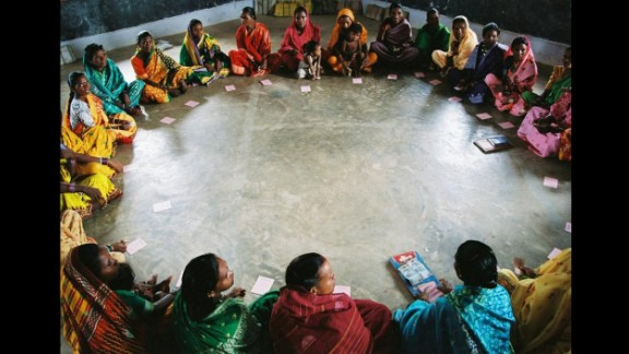 Members of a self-help group organized by Gram Vikas meet in Mohulpalli village in the Bargarh district of Orissa, India. Gram Vikas is a nongovernmental organization that was drawn to Orissa in the 1970s to help communities that had been ravaged by a cyclone. Executive Director Joe Madiath originally focused on providing renewable energy for rural communities, building more than 54,000 biogas units. Over time, the group has championed a more holistic model of development, based on Madiath's conviction that  healthy living practices and  improved quality of life are necessary before total development can occur.