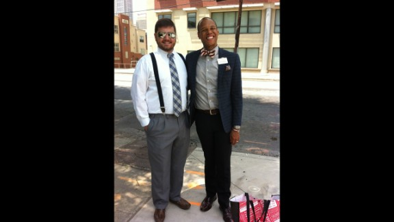 Gibson poses with his friend, Drew Harvil, in May 2013 at Emory University in Atlanta, where Gibson works.