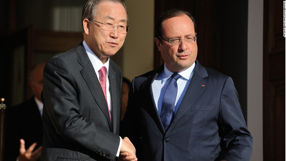 UN Secretary General Ban Ki-moon, left, and French President Francois Hollande pose after a bilateral meeting in the sidelines of the G-20 summit on September 6.