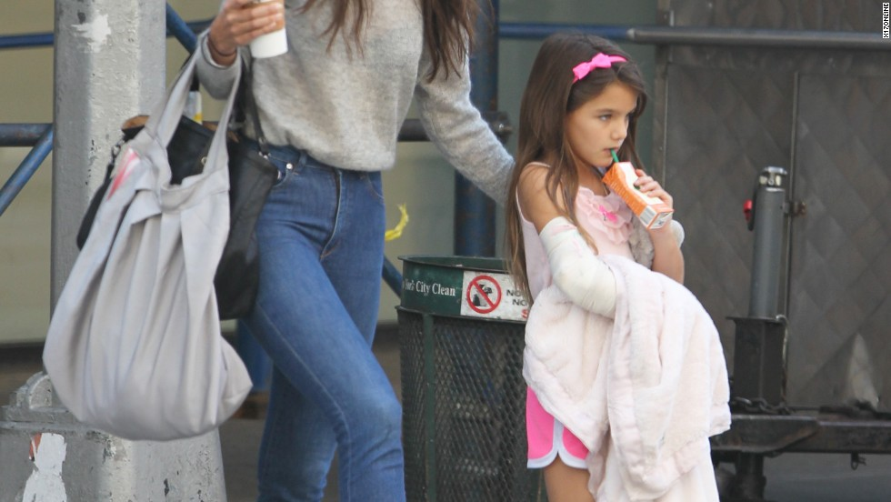 Suri Cruise keeps a strong grip on her juice box and blanket while out with mom Katie Holmes on September 5.