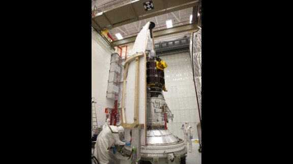 NASA engineers at the Wallops Flight Facility in Virginia load the spacecraft into the rocket's nose-cone. LADEE is the first spacecraft designed, developed, built and tested at NASA's Ames Research Center in Moffett Field, California.
