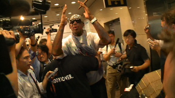 In Beijing Dennis Rodman is rushed away after he is mobbed by reporters asking about his second trip to North Korea in a year.