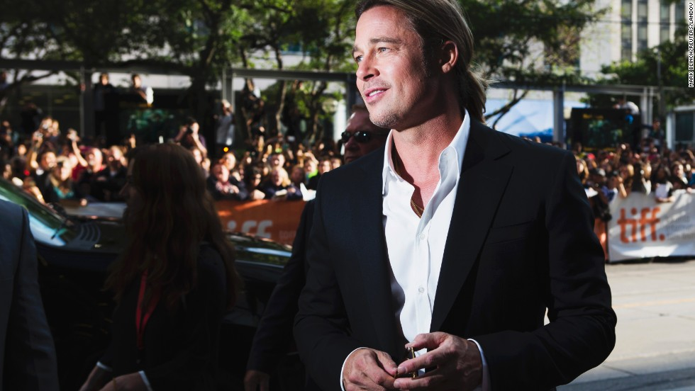 "Actor Brad Pitt arrives for the screening of the film ""12 Years a Slave"" at the film festival on Friday, September 6."
