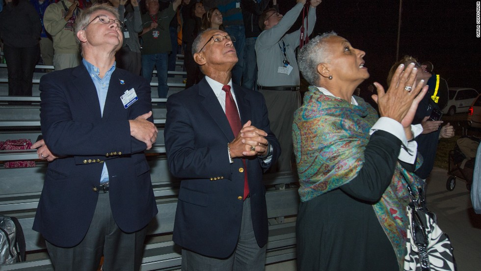 David W. Thompson, chairman and CEO of Orbital Sciences, left, NASA Administrator Charles Bolden and Mrs. Jaqueline Bolden watch the launch on September 6.