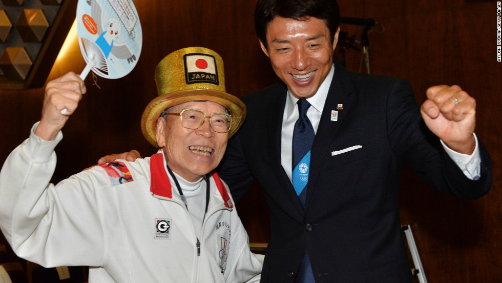 "Octogenarian ""Olympic superfan"" Naotoshi Yamada (L) and former Japanese tennis player Shuzo Matsuoka (R) were among those to cheer the announcement in the early hours in Tokyo."