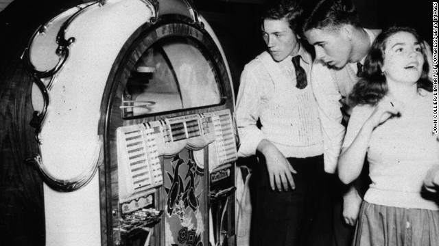 Teenagers stand by a jukebox in a dance hall in Richwood, West Virginia in September, 1942.