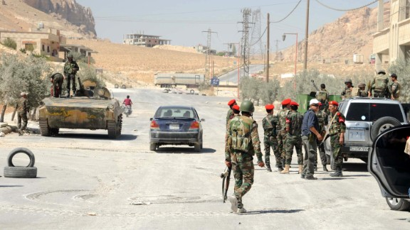 Syrian forces are seen in the Syrian Christian town of Maaloula on September 7.