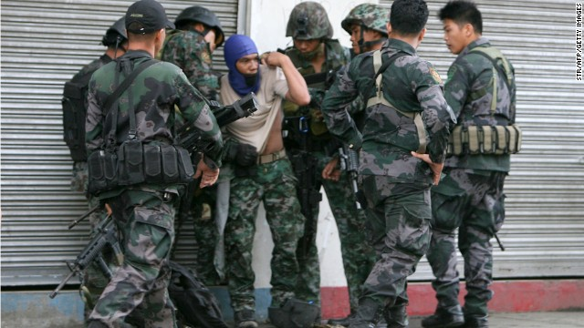 A soldier is helped by comrades after being injured during skirmishes with rebels in Zamboanga City on September 9.