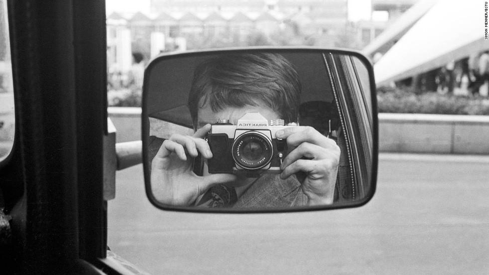 A Stasi agent takes a picture of himself in the car.