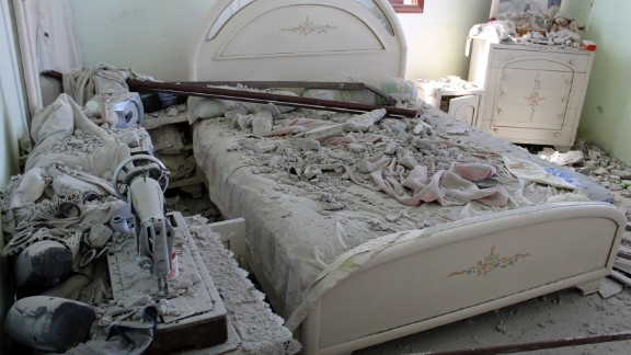 A bedroom lies in ruins after clashes between government forces and rebels around Ariha on September 7.
