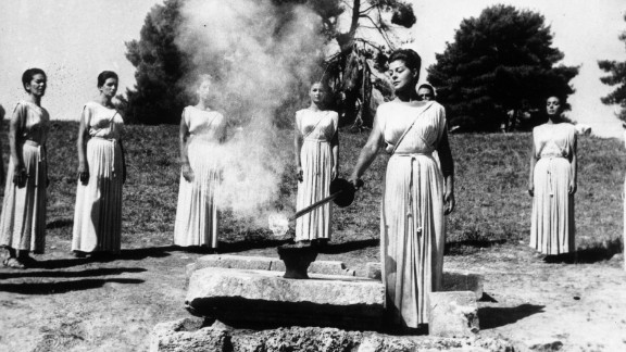 """September 22, 1964: During the ancient ceremony at Olympia, Greek actress Aleca Katseli, lights the Olympic torch which will be carried to Tokyo by a relay of runners. <a href=""""http://cnn.com/2013/09/07/sport/world-olympics-2020/?hpt=isp_c1"""">Tokyo has been chosen by the International Olympic Committee</a> to host the 2020 Summer Games. We revisit the Games hosted by Japan in 1964."""