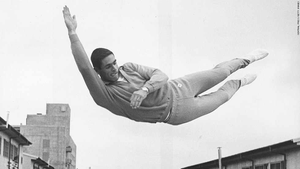 October 1, 1964: American pole vaulter Fred Hansen trains on a trampoline at the Olympic village in Tokyo.