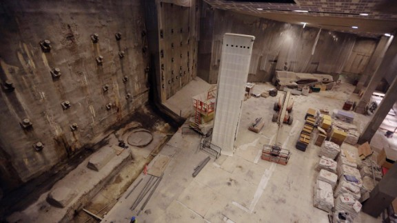 Part of the World Trade Center's original foundation, left, and the last column removed from the WTC site, center, are covered in a protective wrap during construction of the museum.