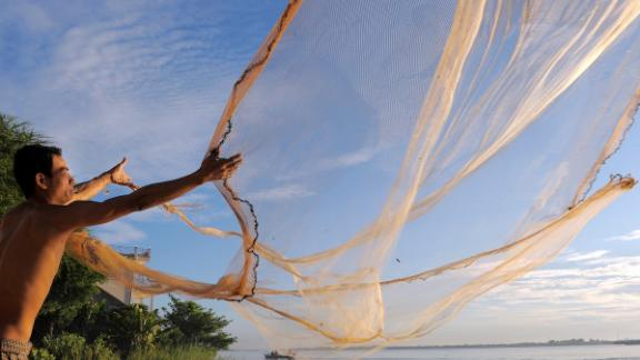 Millions of people up and down the Mekong depend on the river for its resources and also for their livelihoods. Here, a fisherman casts his net into the river in Phnom Penh, Cambodia.