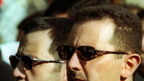 A file picture dated 13 June 2000 shows Syrian President Bashar al-Assad (R) and his brother Maher during the funeral of their father, Syria