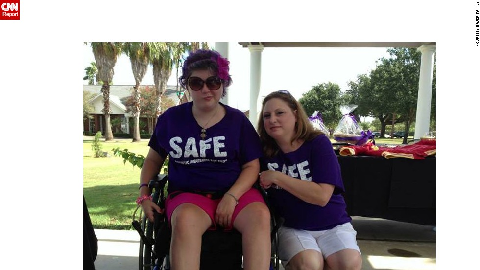"Emily strikes one of her signature faces as she poses with her mom, Tonya Bauer, at a golf tournament fundraiser for <a href=""https://www.facebook.com/safe4emily"" target=""_blank"">SAFE</a> in August."